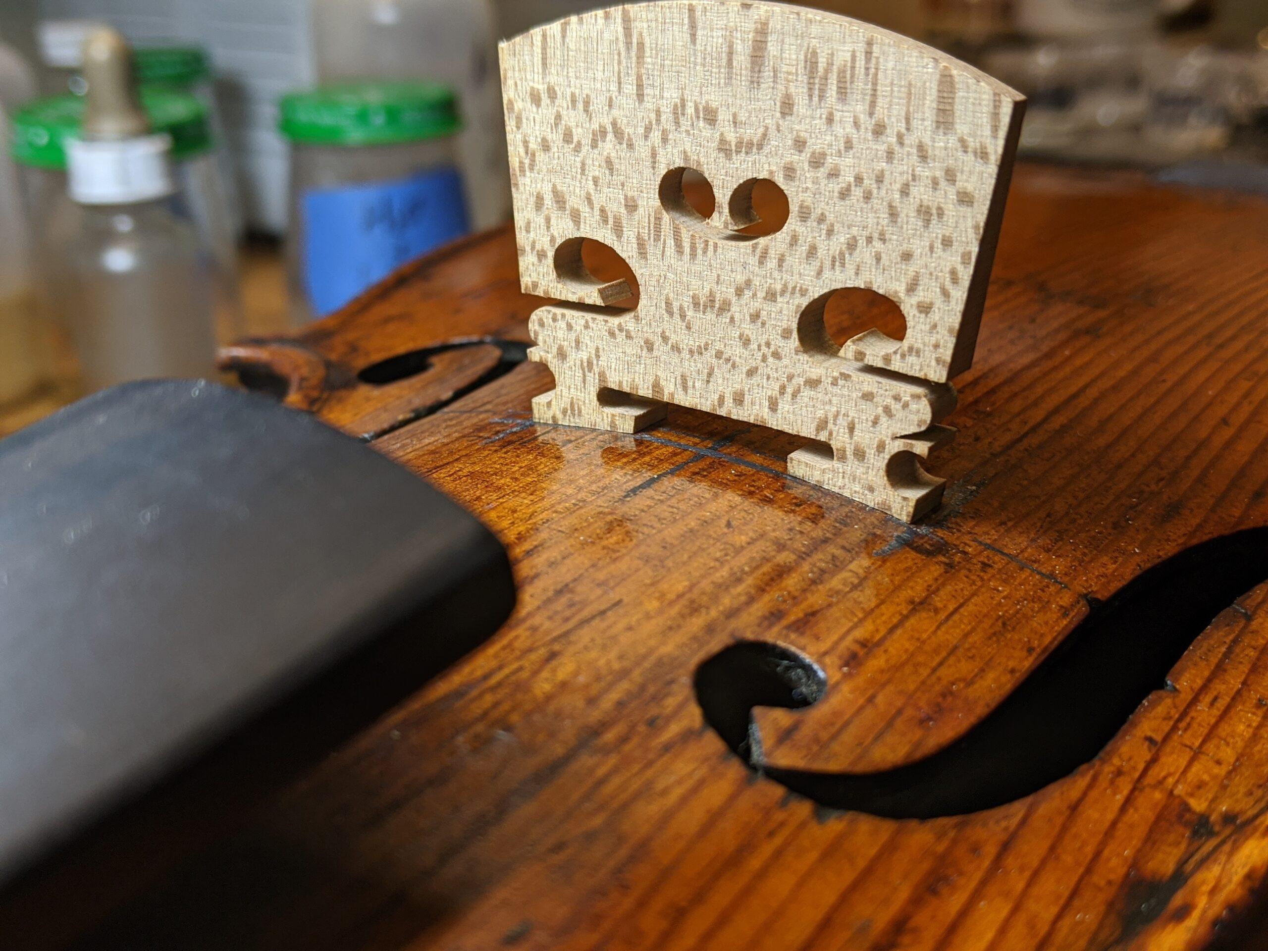 Violin-repair-fitting-new-bridge